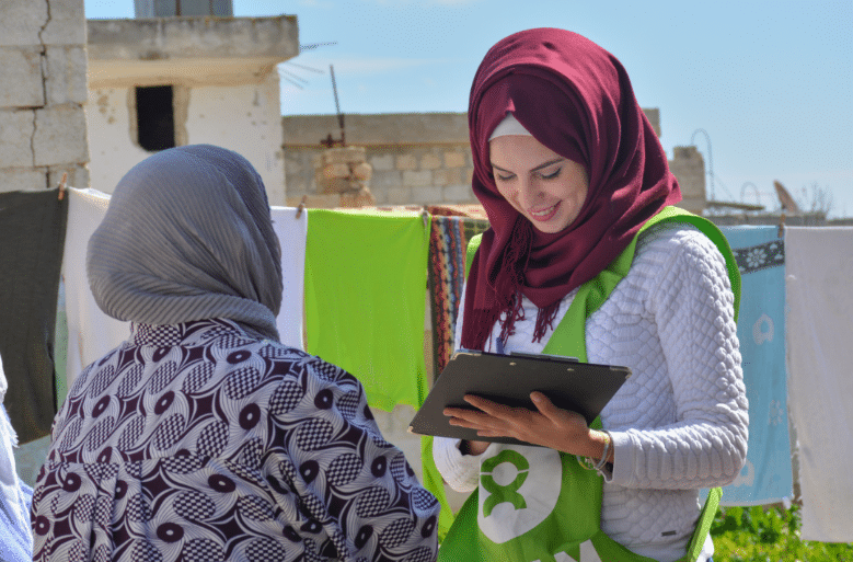 oxfam enumerator collecting data
